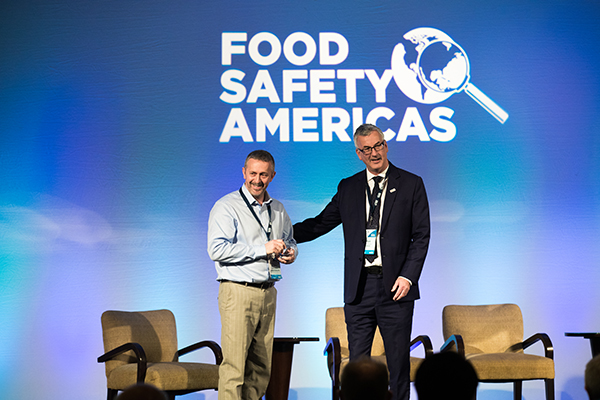 Andrew Clarke being presented the BRCGS CEO Award by Mark Proctor at Food Safety Americas 2019